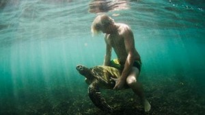 James Obrien Rides Sea Turtle
