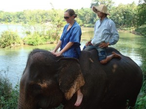 Girl Riding Elephant